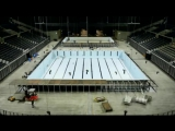 Building a swimming pool inside an arena.