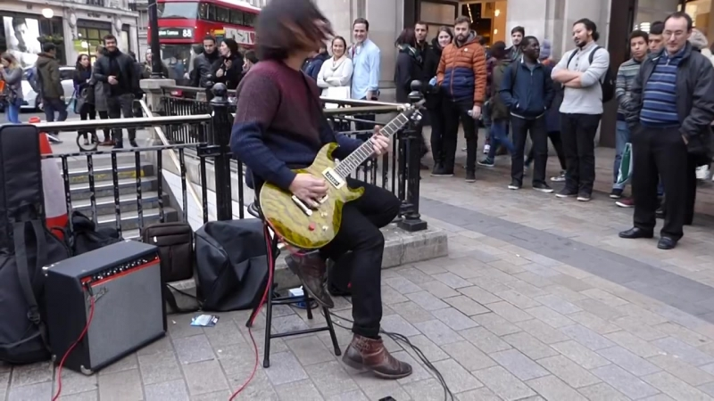 Street musician near the entrance to the London underground.
