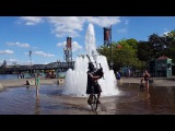 Darth Vader Stays Cool by Riding a Unicycle through a Fountain while Playing Bagpipes