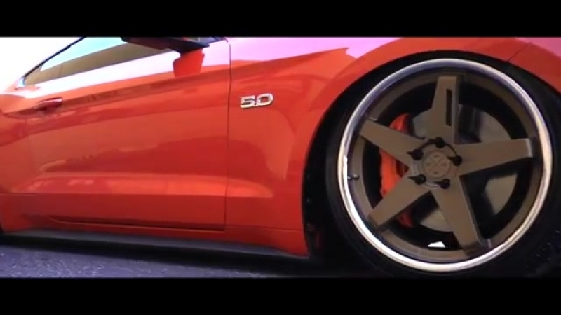Air bagged 2015 Ford Mustang on 20 inch Staggered Blaque Diamond wheels cruises