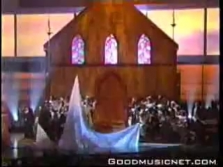 Kanye west at the grammys performing Jesus walks featuring Jhon Legend, blind boys from Alabama
