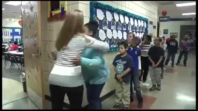 Wichita Public Schools teacher does an individual handshake every morning with her students before they start class. » Freewka.com - Смотреть онлайн в хорощем качестве