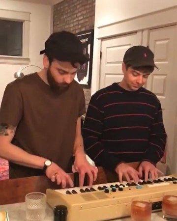 Logan and Taylor play the synthesizer