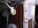 Погрузка бочек в микроавтобус