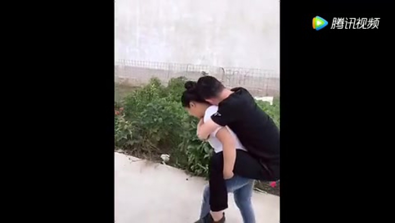 Strong girl force to lift her boyfriend
