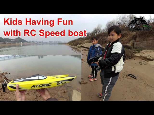 Kids Having fun with RC Speed boat
