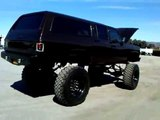 Monster Suburban 4x4 Rolling on Diesel Truck tires and wheels
