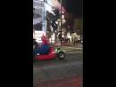 Orlando as Mario and Katy as Luigi in a Mario Kart race around Tokyo!