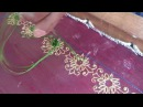 Can you name the embroidery technique used to create the green flower