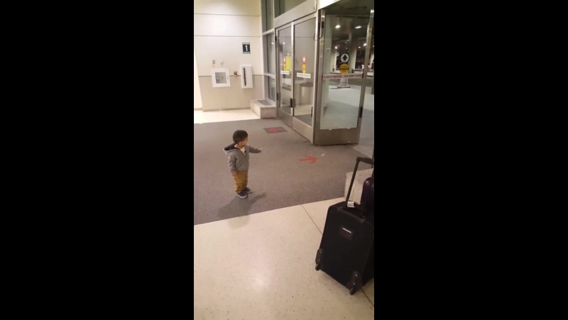 Kid thinks he's opening automatic doors with his powers.