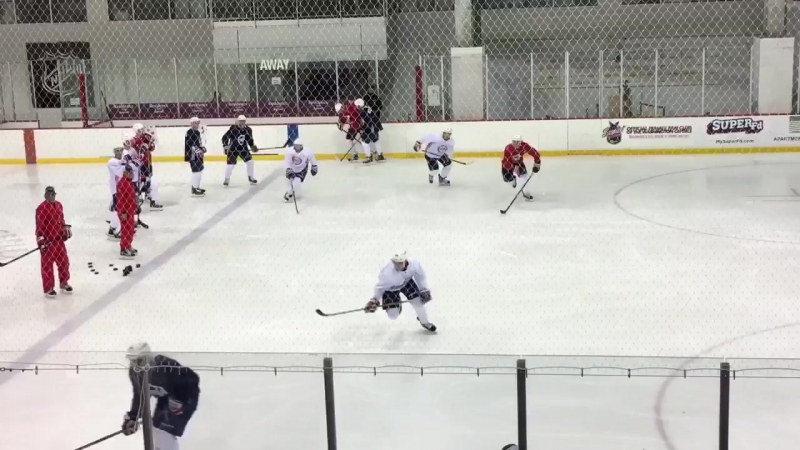 The top line of the red group getting some reps in