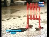 Автомобиль застрял в яме на асфальте в самом центре Иркутска