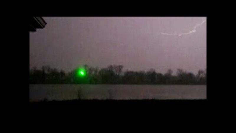 Green UFO illuminates the sky; In the United States of America