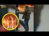 WTF! Woman runs out of a burning building while completely in flames Graphic