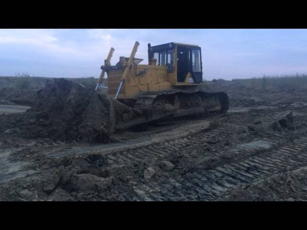 Backfilling of the soil with bulldozers on the pipeline from Filonovsky Caspian sea