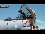 Assad tries out role of Su-35 fighter jet pilot at Russias Khmeymim airbase