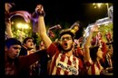 @Supporters of Atletico Madrid sing after the final victory of the Europa League over Marseille@