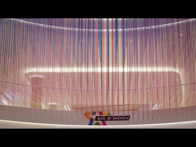 HOTTEA's suspends 13,000 strands of colored yarn inside mall atrium
