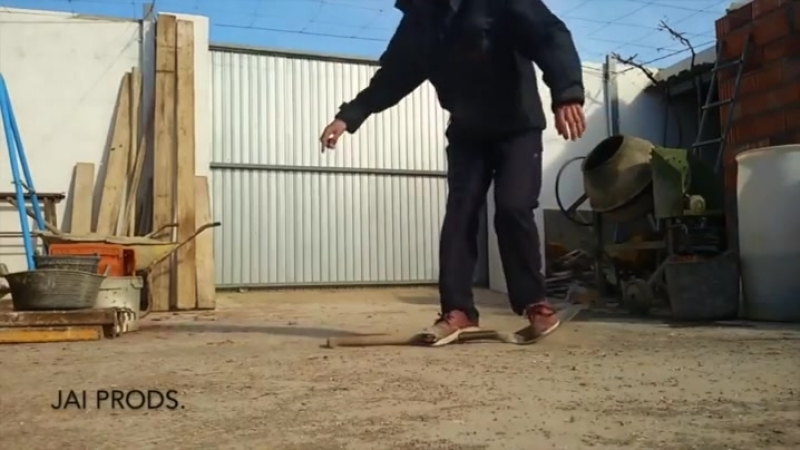 Doing skateboard tricks on an old shovel