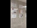 Сертификаты и лицензии на стене процедурного кабинета.