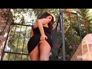 Charlotte Springer Busty British model in black dress