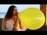 Yellow Tuftex 17'' balloon blow to pop