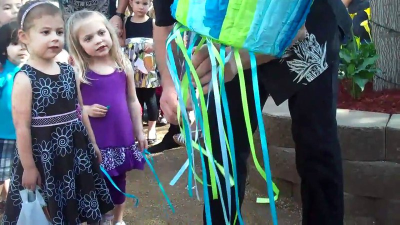Colby pulls a string! All the kids at the pinata!