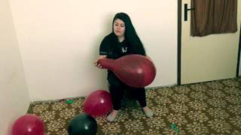 Girl sit to pop balloons