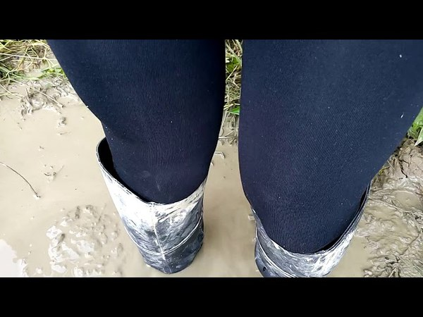 Girl in dirty leather boots and in a denim skirt in mud 1 VID 20170720 154757re