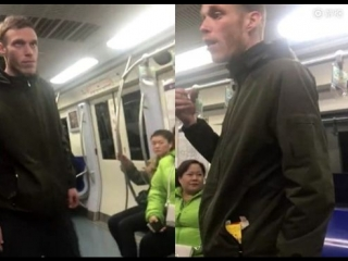 Chinese commuters confront foreigner smoking on Beijingsubway