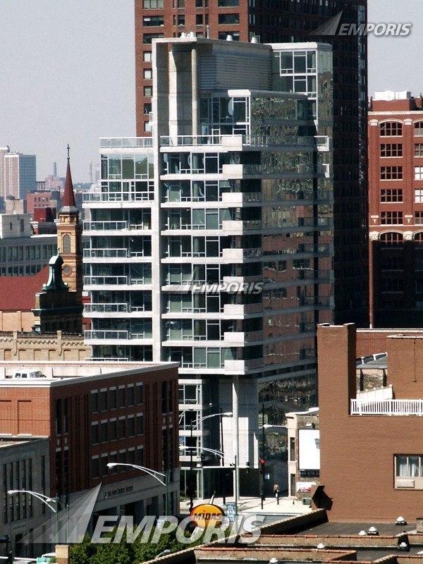 Contemporaine is a 28-unit condominium building located on a corner lot in the River North area of urban Chicago / Perkins   Will
