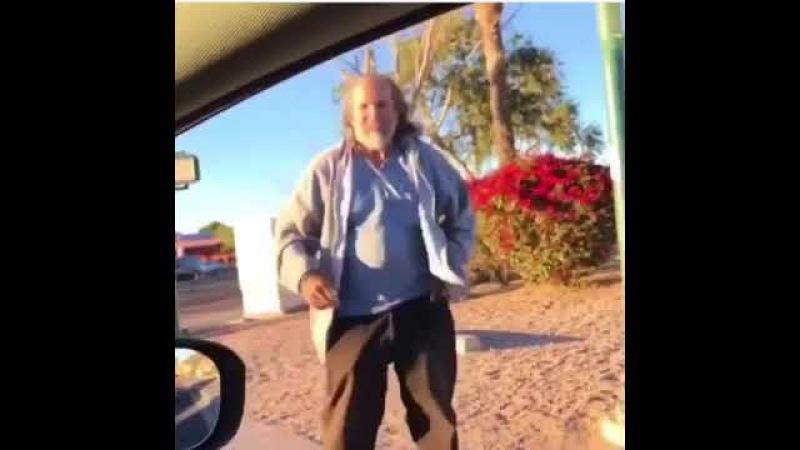 Homeless guy dancing to plug walk