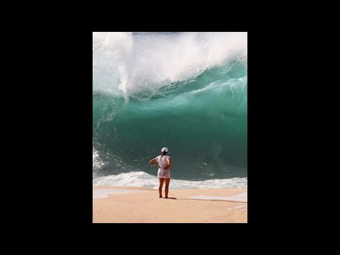 Unexpected wave swallows woman..
