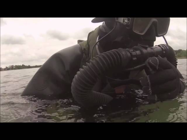 Black Rubber Drysuit Diver Walking and Submerging Slo Mo