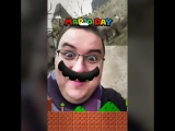 Антон Логвинов в маске с усами Марио.
