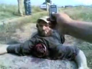 Русские ребята отрезали голову чеченцу да и ХУЙ с ним пидорасам!