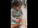 Анечка играет с планшетом