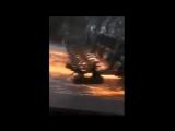 Трактор несется по асфальтированной дороге с опущенным плугом