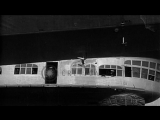LZ-127 Graf Zeppelin airship in flight and being maneuvered on ground, at Lakehur...HD Stock Footage
