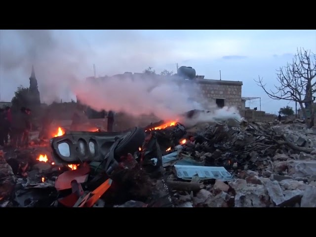 Wreckage burns after Syrian rebels down Russian plane, kill pilot
