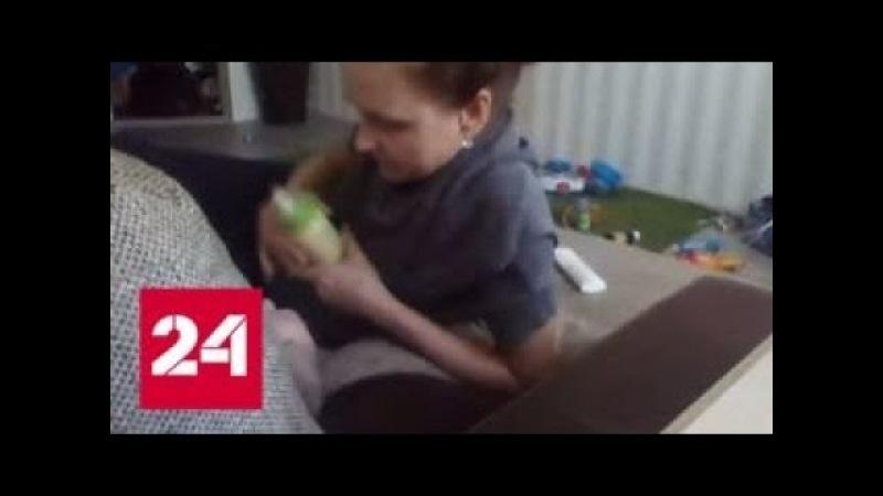 Избивавшая младенца за отказ пить молоко няня попала на видео - Россия 24