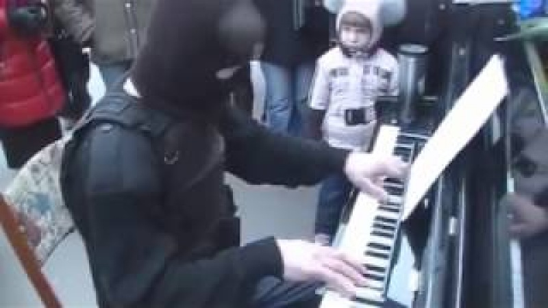 Ukrainian soldier playing music to study to on piano