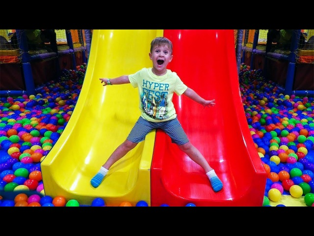 Fun kids playing on the Indoor Playground family fun / Nursery Rhymes Songs for children and babies