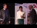 Prince Harry and Meghan Markle join students on stage as they receive award