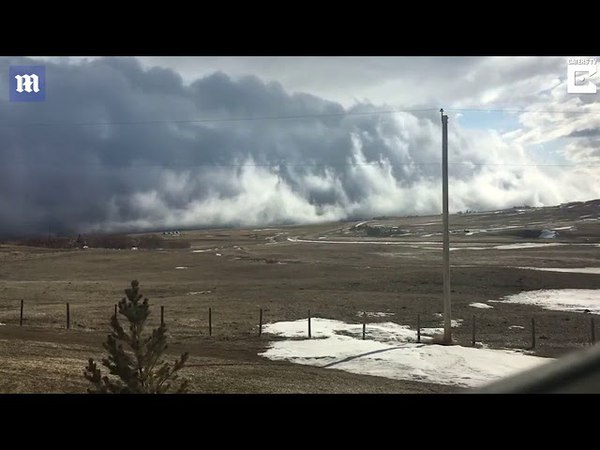 Footage shows huge low rolling cloud drifting over horizon