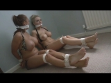 two pirate girls are in bondage