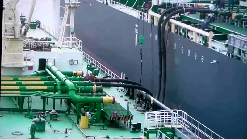 Berthing ship to ship and loading of cargo.