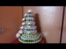 Свадебный подарок из шоколада конфет денежных купюр и бумажных цветов с конфетами внутри