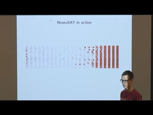 NeuroSAT: Learning a SAT Solver from Single-Bit Supervision