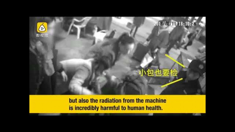 """A woman in SE China climbed into a security inspection machine to """"escort"""" her purse"""